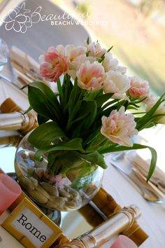 FRESH TULIPS IN 20CM FISHBOWL - These stunning fresh pink tulips are arranged in fishbowls with pebbles and are surrounded by a bamboo frame.