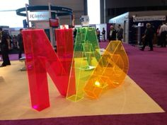 Giant Lucite Lux® letters in the North American Products booth. Makes a statement