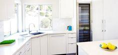 Premier EuroCase | Reflekt High Gloss used in modern white kitchen in San Jose, CA