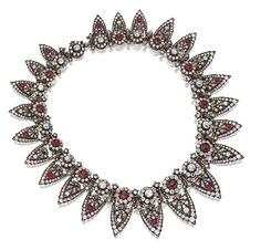 A belle epoque diamond and ruby tiara necklace combination, 1880s, featuring twenty-three diamond arches, with alternating duamond and ruby clusters at the base of each.
