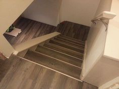 Drop & Done Luxury Vinyl Plank in Eastern Township with metal insert stair nosing.