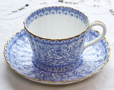 Delicate pleated bone china Teacup with a pattern of Persian flowers and fine gilding