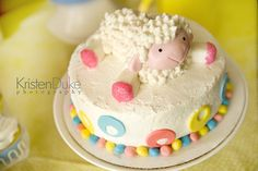 Mary Had a Little Lamb nursery rhyme themed second birthday party in pink blue yellow cake with lamb topper and marshmallow feet