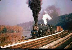 Baltimore & Ohio steams eastbound along the Youghiogheny River near Connellsville, Pennsylvania on October Bob Collins photo. Baltimore And Ohio Railroad, Rolling Stock, Steam Engine, Steam Locomotive, Train Travel, Worlds Largest, Old Things, Ebay, Vintage Trains