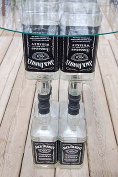 Fun DIY Ideas Made With Jack Daniels - Recipes, Projects and Crafts With The Bottle, Everything From Lamps and Decorations to Fudge and Cupcakes |  Upcycled Jack Daniels Liquor Bottle Table Idea  |   http://diyjoy.com/diy-projects-jack-daniels