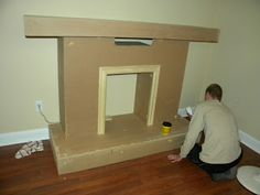 Confessions of A Cf wife: Dr.Appointment and Faux Fireplace - Confessions of A Cf wife: Dr.Appointment and Faux Fireplace - Faux Fireplace Diy Cardboard, Fake Fireplace, Christmas Fireplace, Christmas Mantels, Diy Christmas, Christmas Decorations, Diy Cardboard Furniture, Cardboard Box Crafts, Playhouse Furniture