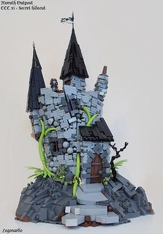 Tower #LEGO Custom Design by Legonardo Davidy. The crooked towers are excellent. The details on the rock it sits on are amazing too. Wonderful MOC