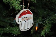 Hand Print Santa Ornaments - Kids will love making these Christmas ornaments out of salt dough.
