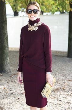 Olivia Palermo in a turtleneck tucked into a pencil skirt, and snake print clutch