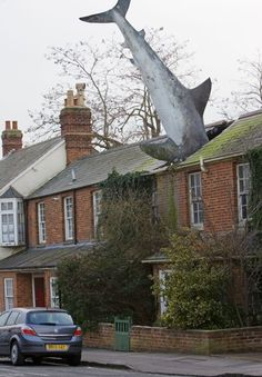The Headington Shark, Oxfordshire, UK  If there's one place you don't expect to see a shark, it is in a residential street in Headington, Oxfordshire. Created by sculptor John Buckley and installed at the request of owner Bill Heine in 1986, it was designed to be a political statement to reflect the times**