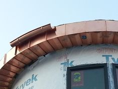 The first piece of the radius gutter installed. We knew it was a waste of time, but we checked the fit of the radius anyway. Of course it fits.) You can count on all our pieces to be no less than perfect. Copper Roof, Metal Roof, Architecture Details, Planters, Exterior, Inspiration, Auburn, Barrel, Windows