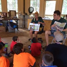"""""""A Home for Ozzie"""" authors Amy Costa, Eco Adventure assistant director, and Jake FitzRoy, Environmental Education programs coordinator, read the new children's book to local students."""