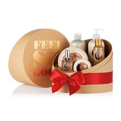 Deliver nutty delight this festive season with The Body Shop's Shea Ultimate Luxuries Gift Set - our most indulgent Shea body collection yet. It contains 3 moisturizers, from light Body Whip to silky Beautifying Oil to lusciously thick Body Butter, as well as the richest cleansing and fragrance treats. It all comes wrapped up with a beautiful red bow, and it's made with Community Fair Trade shea butter from Ghana.