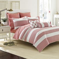 Transform your bedroom into a relaxing retreat with the charming Southern Tide Breakwater Comforter Set. Adorned with a classic stripe pattern, the vintage red and white bedding is a soothing addition to any room's décor.