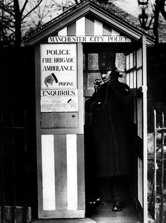 Manchester City Police's PC Harry Knowles makes a call from the city's first police box. The box, situated near the Ben Brierley public house on Moston Lane, was constructed in 1928. To find out more please visit http://www.gmpmuseum.com
