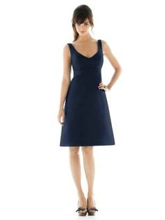 Cocktail length v-neck dupioni dress with matching empire waistband. Shirring detail at back skirt