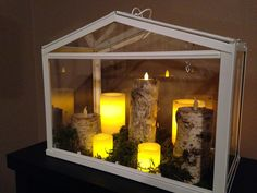 IKEA hack, greenhouse to faux fireplace.