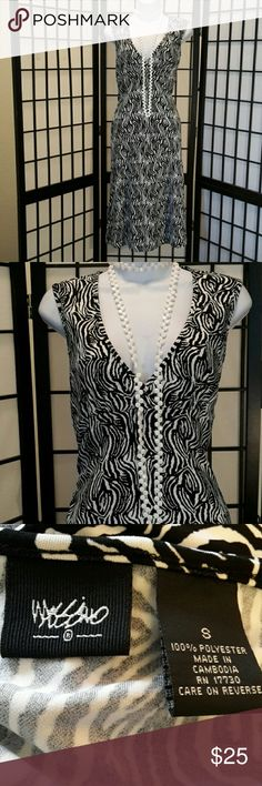 👗Black White A-line Career Dress Never Worn, Accessories not included, Empire Waist, Cool Print, Sleeveless, Stretch, V-neck, Very Format Fitting, Flare, Nice. Thanks for sharing my closet, I will ALWAYS show Posh love by doing the same. Mossimo Dresses