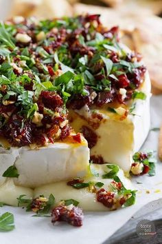 If you are looking for a show-stopping appetizer that only takes minutes to make, this Baked Brie Recipe with Sun-Dried Tomatoes is your answer! Melty cheese is topped with a mixture of sun-dried tomatoes, garlic and parsley in this addictive starter. Tapas Recipes, Cheese Recipes, Appetizer Recipes, Appetizer Ideas, Meat Recipes, Baking Recipes, Bread Appetizers, Chicken Recipes, Baked Brie Appetizer
