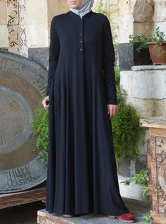 Say salam to your new favorite abaya! Designed for ultimate comfort, the Shirtdress Abaya with Godets is made to resemble the classic SHUKR tunic. Cut to flow, flatter, and fit, this abaya provides a beautiful street style perfect for wear practically anywhere! Please note that the Black and Midnight Navy colors is 2-3cm shorter than the measurements listed in our Garment Measurements chart. The Garment Measurements chart refers to the lengths of the Forest Night, Pinecone and Plum colors.