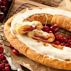 Wisconsin Kringle - We are proud to claim Kringle as our Wisconsin State pastry and created this new Kringle flavor with ingredients farmed and grown in Wisconsin.  We have combined cream cheese, Door County cherries and cranberries fresh from the bogs which we are proud to say are all from the State of Wisconsin.  Enjoy a true blend of Wisconsin flavors.  Creamy, sweet and tart, all in one Kringle.  When you say Wisconsin, you've said it all...Kringle!