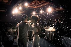 Wedding couple exchanging their wine during toast