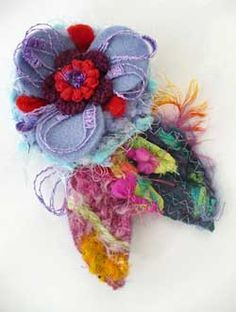 Brooches made of fabric, trimmings, threads http://www.elenafiore.it/bijoux.htm