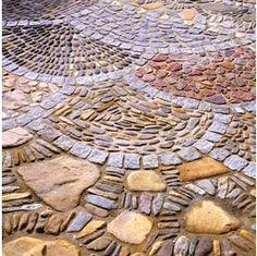 Mosiac surface made with bricks and stones