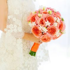 This stunning bouquet includes coral Antike garden roses, white freesia with green buds, and white stephanotis. #LuxBride #Wedding #Bouquet