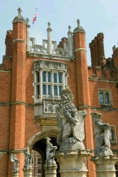 Hampton Court Palace, the beloved seat of Henry VIII's court, and sprawled elegantly beside the languid waters of the Thames, is a magnificent Tudor red-brick mansion begun in 1514 by Cardinal Wolsey to curry favor with the young Henry, and the larger 17th-century baroque building, which was partly designed by Christopher Wren (of St. Paul's fame).