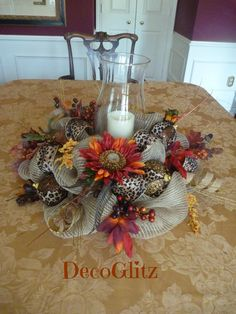 This 21 centerpiece will be a beautiful addition to your festive Thanksgiving table! It features leopard ribbon, beautiful fall sunflowers, fall