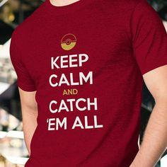 """This Pokemon shirt puts a gamer twist on the """"Keep Calm and Carry On"""" motif and comes in six awesome colors. The Pokeball detail adds a touch of fun and shows other gamers that you are a serious Pokemaster! The soft cotton fabric will keep you comfy as you finish your Pokedex. This playful tee would make a great birthday gift for the Pokemon Go lover in your life! Buy one of these Pokemon shirts for yourself and one for your BFF or partner and wear them on your next Pokemon Go outing…"""