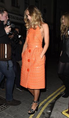 Suki Waterhouse in an orange croc Miu Miu dress and polkadot platform shoes