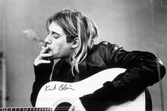 Classic black and white image of Kurt Cobain smoking a cigarette. Dimensions are 24 x 36in. NM condition.