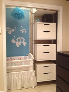 tiny urban nursery for baby boy in closet of 450 sq ft apartment with turtles and storage!