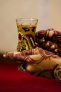 Red Tent / Moon Lodge activities: henna with womb tea.... beautiful glass....want to do my raspberry tea in such a thing!