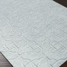 Hand-loomed wool rug with an interlocking trellis motif.  Product: RugConstruction Material: 100% Wool