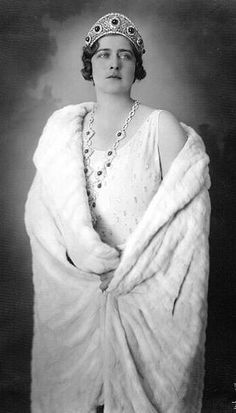 HM Queen Marie of Yugoslavia née HRH Princess Marie of Romania, wearing the emeralds of her great aunt Elizabeth Grand Duchess Sergei of Russia which her husband bought from Grand Duchess Marie Pavlovna the younger after the revolution.