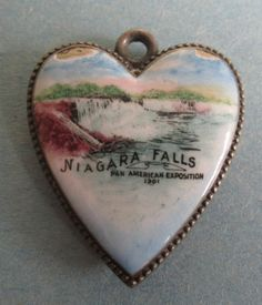 Antique Silver and Enamel Souvenir Niagara Falls Puffy Heart Charm made for the Pan American Exhibition of 1901