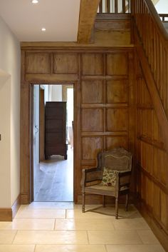 Wooden panels in the hallway provide a traditional feel to the home but with modern features to light up the rooms.