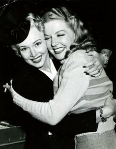 "Carole Landis and Ann Sheridan on the set of ""Nora Prentiss."""