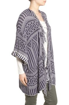 Made with a fluffy fringed collar, this jacquard-knit sweater from the Nordstrom Anniversary Sale has a cool bohemian feel with a relaxed, kimono-inspired silhouette.