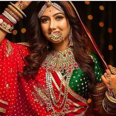 Red and green are the most authentic colors for Indian Weddings! After a long time we came across a bridal look with a perfect combination of red and green and intricate jewellery! Totally gushing over the look Indian Bridal Outfits, Indian Bridal Makeup, Indian Bridal Fashion, Nath Bridal, Bridal Chura, Bridal Jewelry, Rajasthani Bride, Rajasthani Dress, Indian Wedding Bride