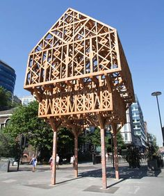 """""""Paleys upon Pilers"""", palace on pillars - latticed timber hut on stilts -the wooden folly was inspired by the dream-like temples described in two poems written by historic Aldgate resident Geoffrey Chaucer -  it now marks the direct routefrom the City of Londonto the Olympic Park - designed byHackney architectsStudio Weave"""