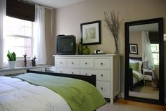 Bedroom idea.. I like the pop of color.. The neutral wall color and the white and black accents.