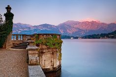 Italy -  Heavenly. / The last rays of sun reflect of the mountain peaks surrounding Lake Como.