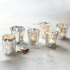 Mercury candle holders: spray glass with water and then spray paint it silver.