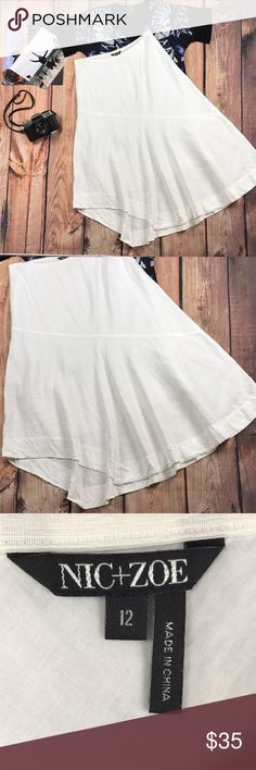 Nic + Zoe White Linen Asymmetrical Lined Skirt This chic and flowy skirt is perfect for any occasion. You''ll turn heads in all situations.   Features: Brand: Nic + Zoe Color: White Pattern: Solid Size:  12 Size Type: Regular Material: Shell 52% Linen 48%Rayon Lining 100% Cotton Measurements: Waist (in): 16 to 19 Elastic Waist Hips (in): 22.5 Total Length (in): 32.5 Sorry No Trades PWS5.35Bin10.43 NIC + ZOE Dresses Asymmetrical