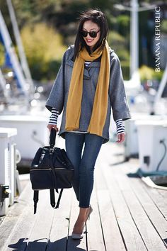 Anh Sundstrom, of @9to5chic, nails the mariner trend with see-worthy layers of texture in blue, gray and pops of yellow. A flannel pullover adds warmth and nautical inspired stripes add layers of style.