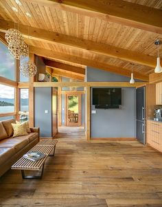 Look at the beautiful modern lines in this small cabin filled with wood and light ~ Idaho Retreat by FabCab | Tiny Homes